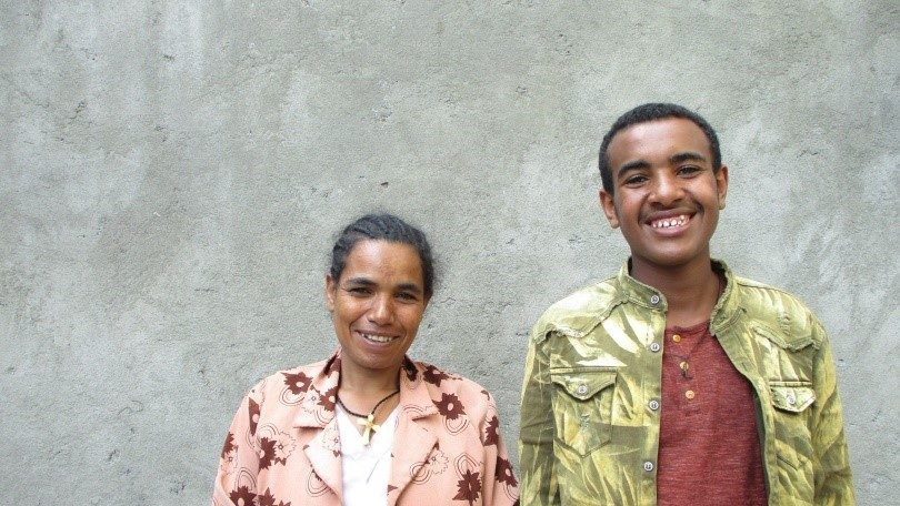 Sponsored boy with his mother